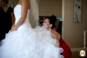 Bride puts on dress