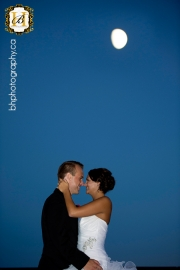 Bride and groom with moon