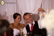 Wedding couple laugh